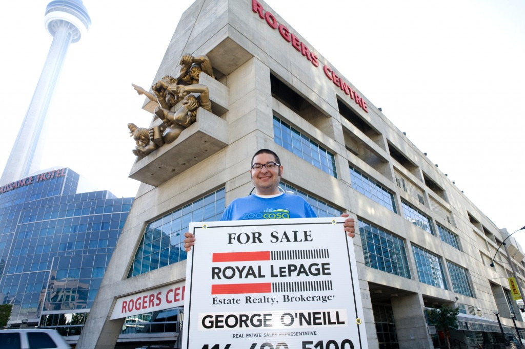 Saul holding sign - Rogers Centre - CN Tower